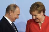 Vladimir Putin i Angela Merkel EPA CLEMENS BILAN