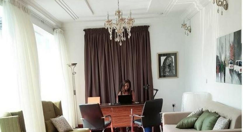 Linda Ikeji working in her office mansion