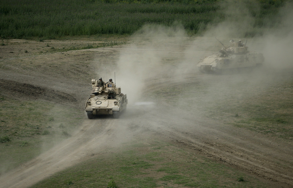 U.S. servicemen drive Bradley infantry fighting vehicles during the joint U.S.-Georgian exercise Noble Partner 2015 at the Vaziani training area outside Tbilisi