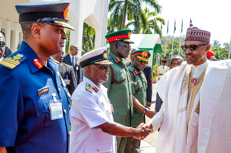 President Muhammadu Buhari and security officials during his 76th birthday