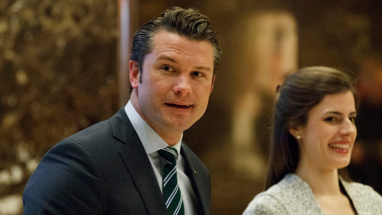 Pete Hegseth, former executive director of Vets For Freedom, walks to an elevator for a meeting with President elect Donald Trump at Trump Tower in New York in 2016.