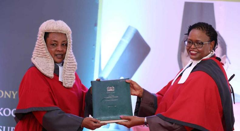 Chief Justice Martha Karambu Koome receives instruments of power and the state of the Judiciary report from Deputy Chief Justice Philomena Mbete Mwilu