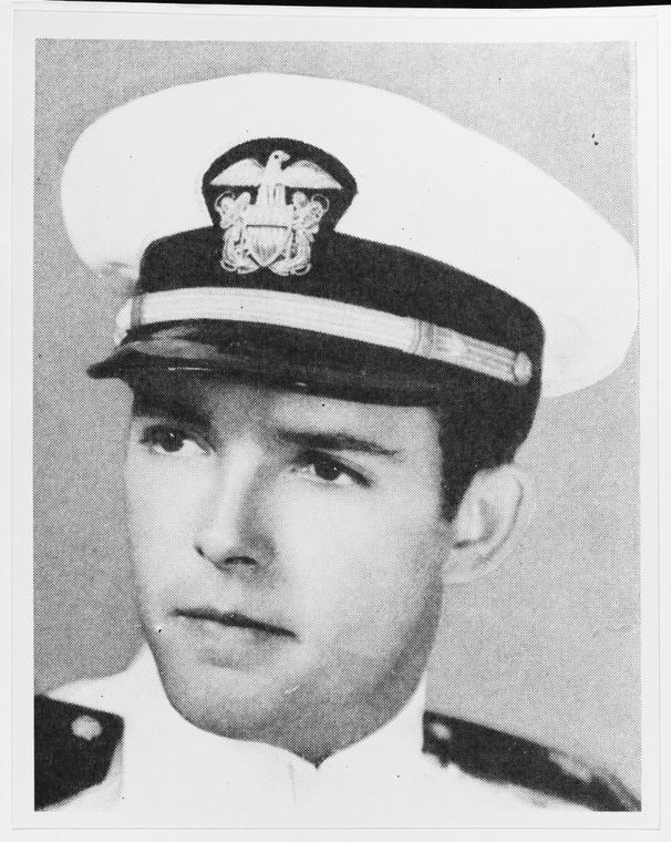 Ensign Herbert C. Jones, who was passing ammunition up to gun crews when he was critically injured.