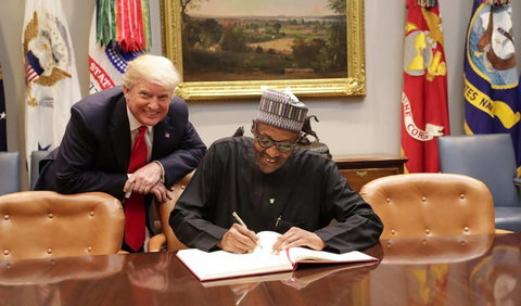 President Donald Trump (L) and President Buhari (R) sign a raft of bilateral agreements at the White House on April 30, 2018 (White House media)
