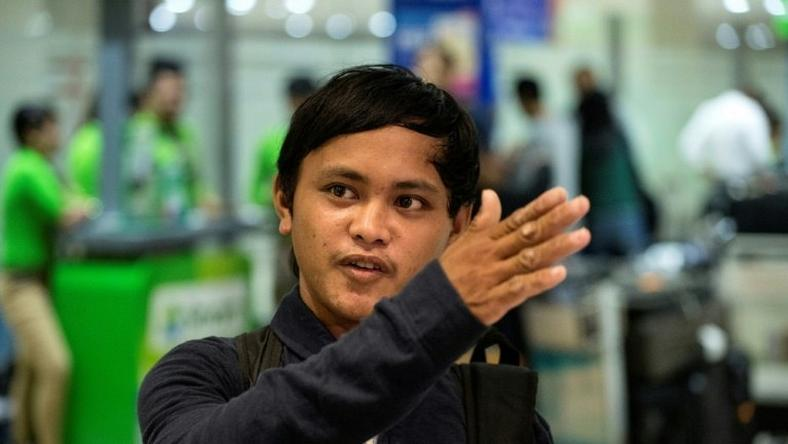 Filipino fisherman Rolando Omongos, 21, arrives at the Manila International Airport on March 29, 2017