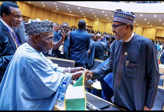 Former Nigeria's President Chief Olusegun Obasanjo and current President Muhammadu Buhari. [Twitter/@BashirAhmaad]