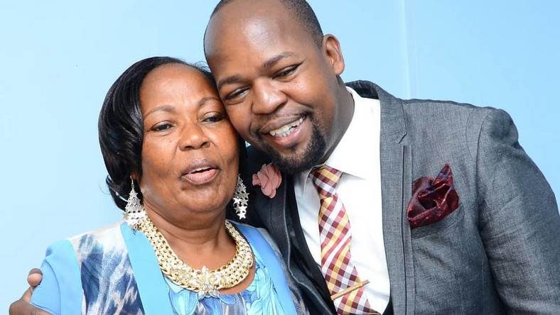Alex Mwakideu with his mother