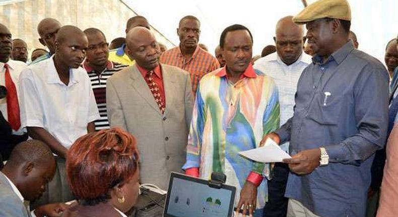 Cord leaders Raila Odinga (right) and Kalonzo Musyoka inspect an IEBC registration centre at Jomo Kenyatta Sports Grounds in Kisumu.