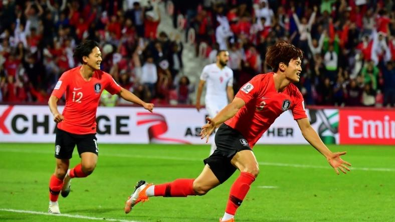 Jin-Su Kim celebrates his extra-time match-winner as South Korea beat Bahrain to reach the Asian Cup quarter-finals