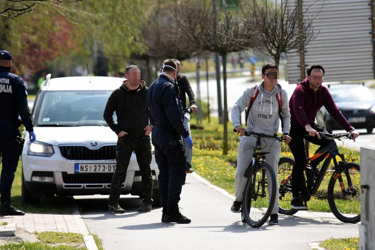 Novi Sad235 lepo vreme vandredno stanje virus korona kovid 19 policija udaljava ljude sa dunavskog keja foto Nenad Mihajlvic