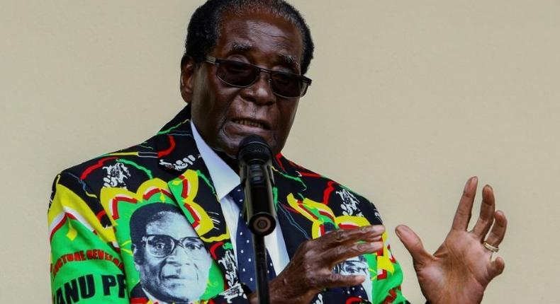 Zimbabwe President Robert Mugabe speaks at the party's annual conference on December 17, 2016 in Masvingo