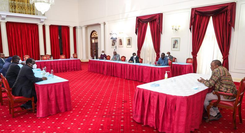 President Uhuru Kenyatta with former PM Raila Odinga, Senate leaders and CoG Chair Wycliffe Oparanya during a meeting in State House, Nairobi