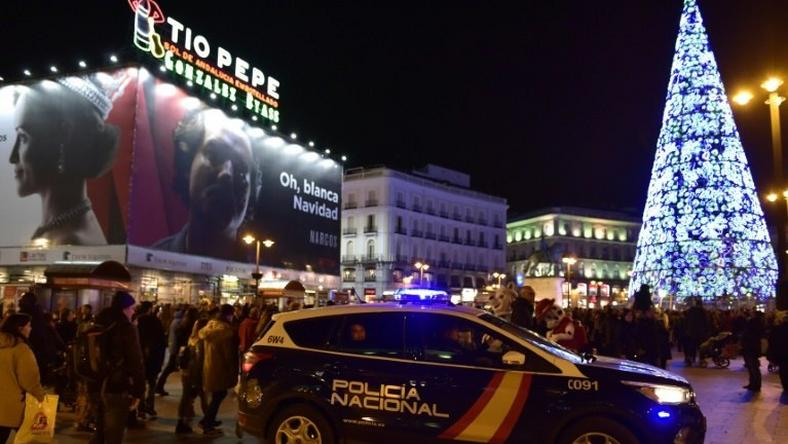 A police vehicle patrols on Plaza del Sol in the centre of Madrid on December 23, 2016