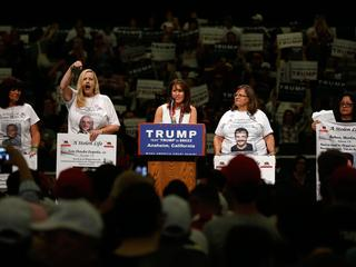 "Women representing ""Stolen Lives"" families take part in a Trump rally in Anaheim"