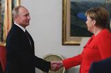 Merkel i Putin EPA Michael Klimentyev