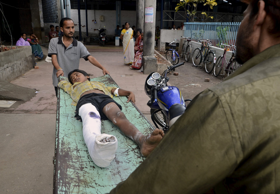 An injured boy is taken to a ward inside a hospital after an earthquake in Siliguri