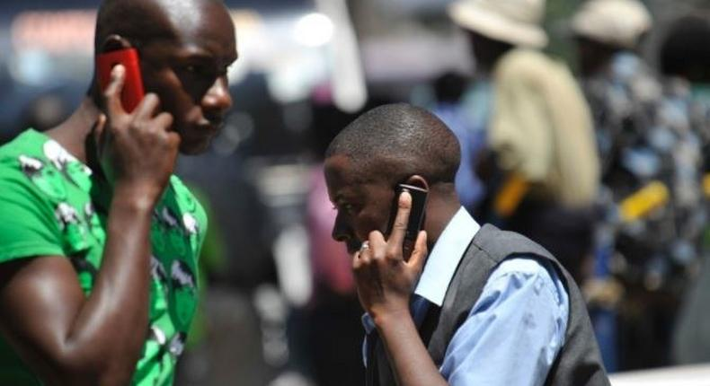 File image of Kenyans calling on their mobile phones.