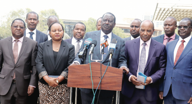 File image of ODM leader Raila Odinga with a section of Mt Kenya region governors and legislators address the press at his Capitol Hill office