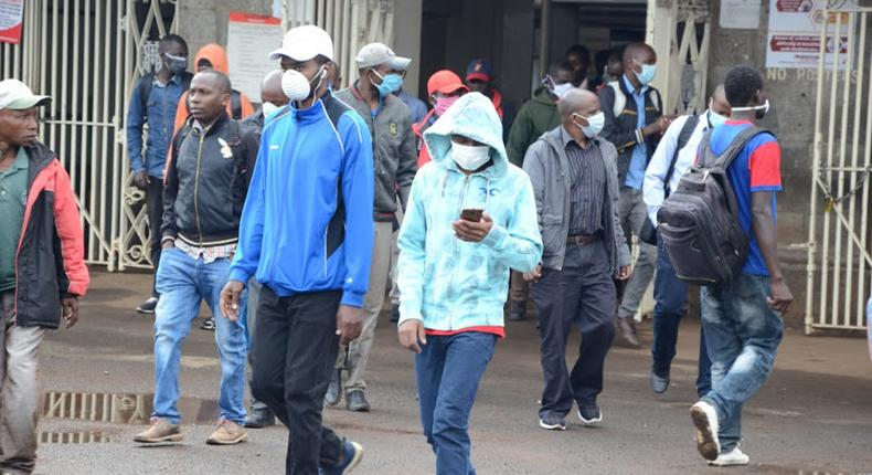 Kenyan citizens wearing masks in public following a government order