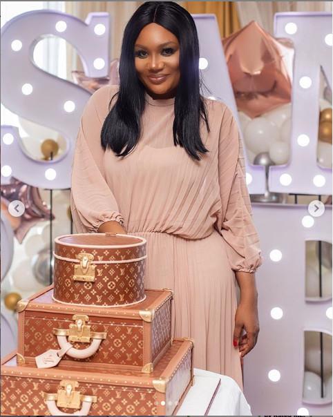 Sandra Ankobia cutting her cake