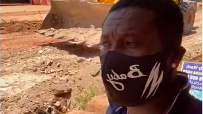 Asamoah Gyan on site of construction