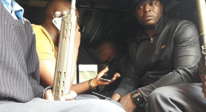 Embakasi Central MP Benjamin Gathiru (in yellow shirt) at the back of a police Land Rover (Twitter)