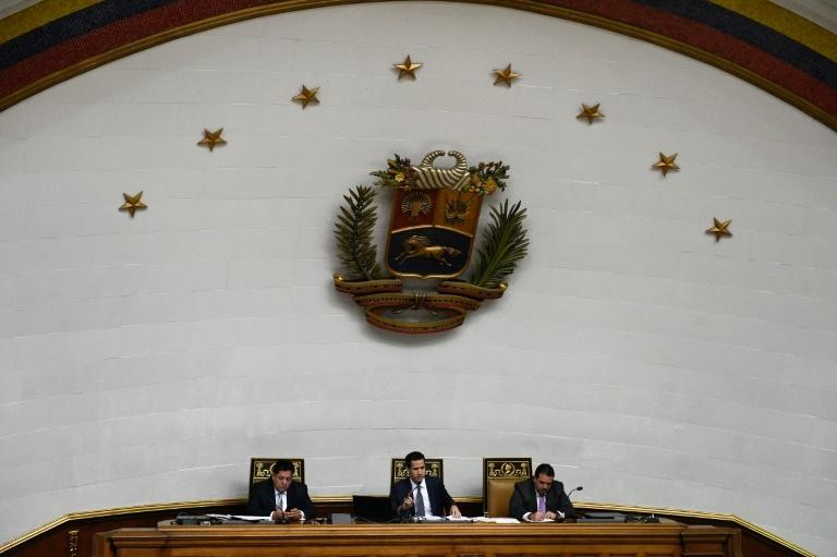 Venezuela's National Assembly president Juan Guaido (C), attends a legislative session of the body which President Nicolas Maduro's regime has stripped of all power