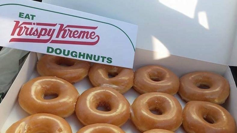 Krispy Kreme is selling a dozen doughnuts for a dollar.