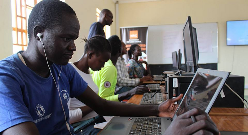 Young people working on their laptops