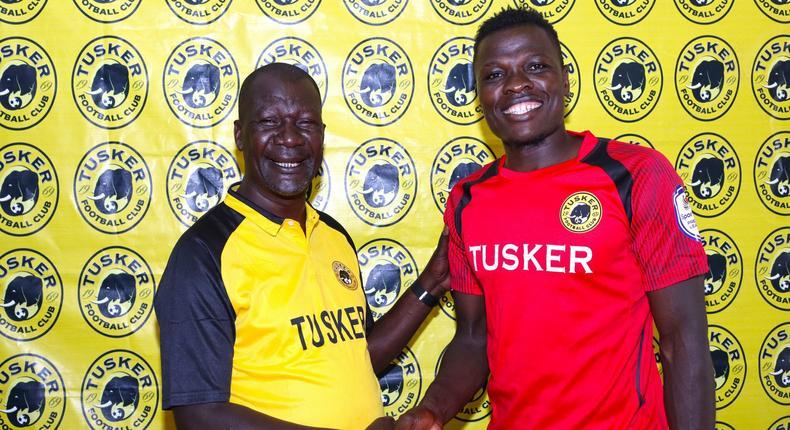 Tusker F.C head coach Robert Matano (left) welcomes new signing Patrick Matasi (right).