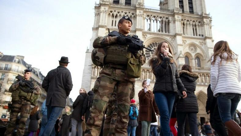 French soldiers patrol outside Notre Dame de Paris cathedral in December 2015