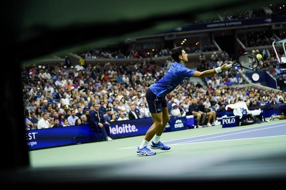 Novak Đoković tokom meča sa Stanom Vavrinkom na US Openu 2019.