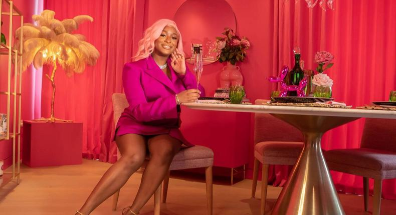 Cuppy wearing a Hanifa dress in her pink pad {Glamour UK}