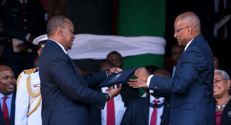 CBK Governor Patrick Njoroge presents the new generation notes to President Uhuru Kenyatta on 01 June 2019  during the Madaraka Day celebrations in Narok