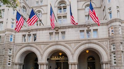 A Forbes reporter says he was banned from the Trump Hotel in Washington after he took photos of a pest exterminators' event
