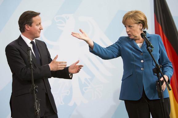 Dejvid Kameron i Angela Merkel