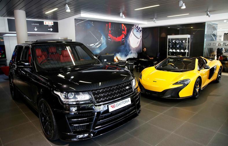 British-made luxury sports cars Range Rover and McLaren.