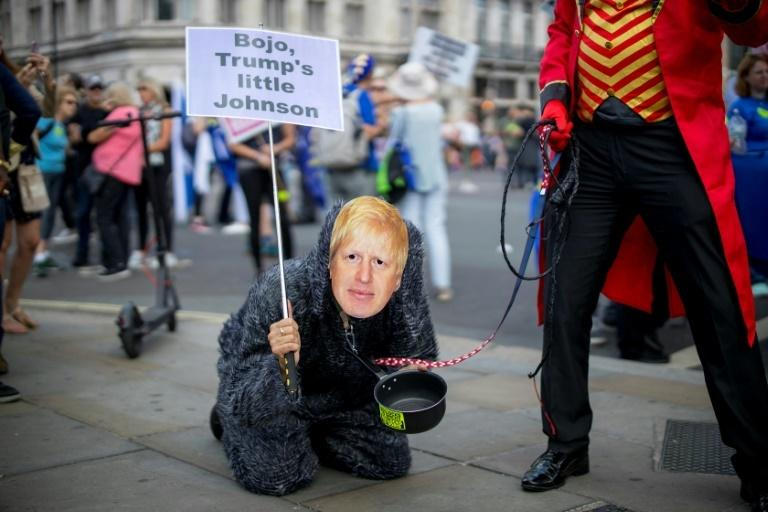 An anti-Brexit campaigner dressed as Conservative party leadership contender Boris Johnson takes part in the March for Change 'No to Boris:Yes to Europe' demonstration in central London