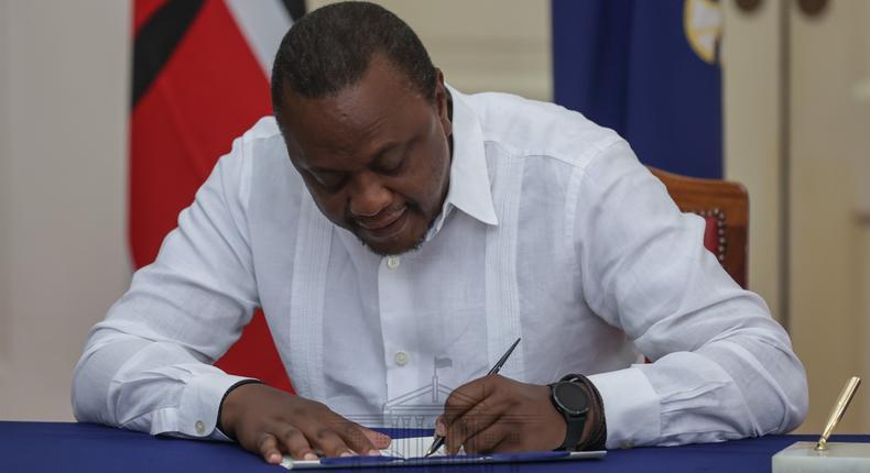 President Uhuru Kenyatta signing the IEBC (Amendment) Bill No. 3 at State House, Nairobi