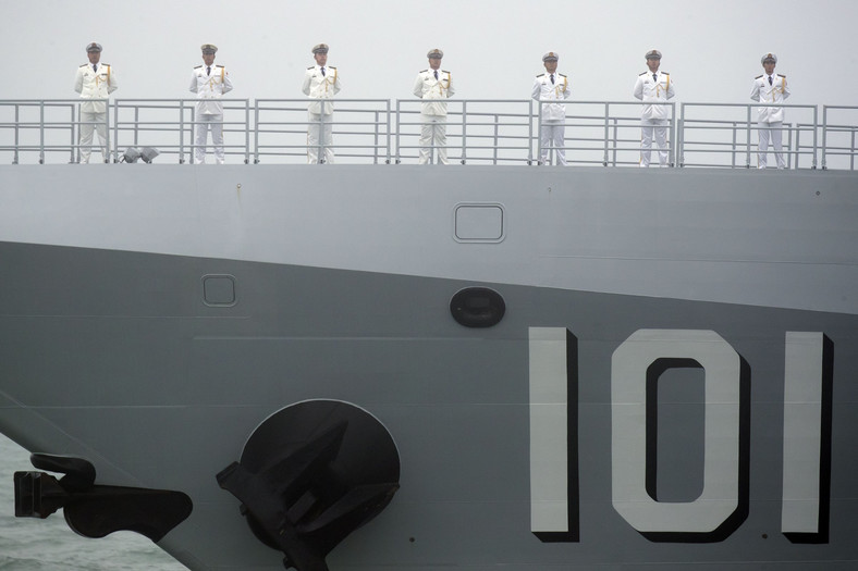 Sailors stand on the deck of the new type 055 guided-missile destroyer Nanchang of the Chinese People's Liberation Army (PLA) Navy as it participates in a naval parade to commemorate the 70th anniversary of the founding of China's PLA Navy in the sea near Qingdao in eastern China's Shandong province, Tuesday, April 23, 2019.