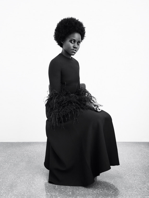 Lupita poses in a black Valentino dress for Another magazine