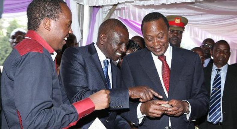 Abel Mutua with President Uhuru Kenyatta and William Ruto