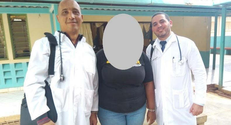 Dr Landy Rodriguez (R) and Herera Correa (L) with a Kenyan community worker (C)