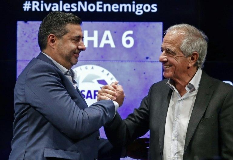 "Boca Juniors' president Daniel Angelici (left) and River Plate counterpart Rodolfo D'Onofrio insist the teams are ""rivals not enemies"""