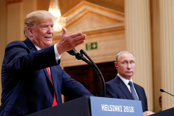 FILE PHOTO: U.S. President Donald Trump gestures during a joint news conference with Russia's Presid