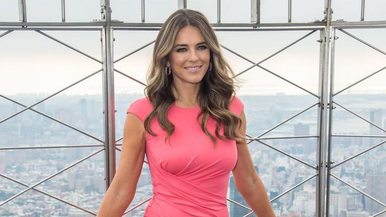 ___9083501___2018___11___8___10___actress-model-elizabeth-hurley-attends-the-lighting-of-the-news-photo-1044311648-1541607274