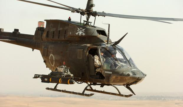 Śmigłowiec OH-58 Kiowa z rakietą Hellfire - na same rakiety tego typu USA wydało w 2016 roku więcej, niż Bułgaria na całe swoje siły zbrojne
