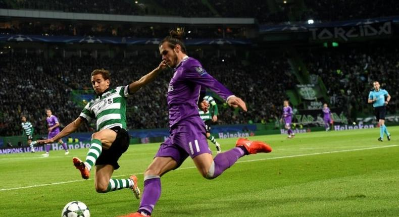 Gareth Bale clashes with Sporting's Joao Pereira during the Champions League match in Lisbon in November