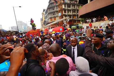 Governor Babajide Sanwo-Olu visits the scene of the fire incident at Balogun Market on Lagos Island. [Twitter/@jidesanwoolu]