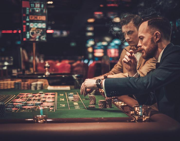 stock-photo-upper-class-friends-gambling-in-a-casino-609287474
